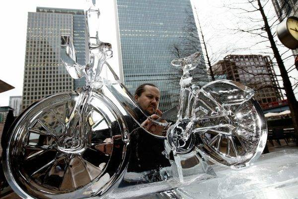 LONDON, ENGLAND - JANUARY 13: Sculptor Krisztian Pogany puts the finishing touches to an ice bike in Canada Square Park in Canary Wharf on January 13, 2011 in London, England. The sculpture is part of the London Ice Sculpting Festival, a three day event that includes polar bear sculpting classes for the public and speed competitions for the professionals. (Photo by Matthew Lloyd/Getty Images)